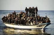 A boat full of would be immigrants is seen near the Italian island of Lampedusa on March 7, 2011.  ©BELGA/AFP/Roberto Salomone