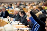 MEPs voting during a committee meeting
