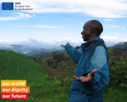 Man shows field of the Naro project western Uganda