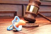 Child custody and forced adoption picture with baby pacifier and a gavel