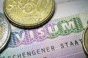 Schengen visa with Euro coins