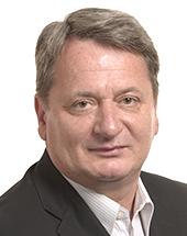 headshot of Béla KOVÁCS