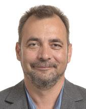 headshot of Tamás MESZERICS
