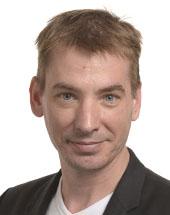 headshot of Benedek JÁVOR