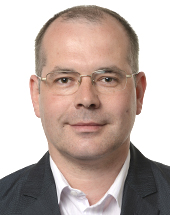 headshot of Andrejs MAMIKINS