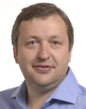 headshot of Antanas GUOGA