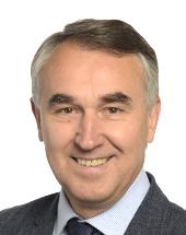 headshot of Petras AUŠTREVIČIUS
