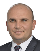 headshot of Ilhan KYUCHYUK