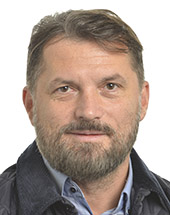 headshot of József NAGY