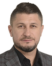headshot of Mihai ŢURCANU