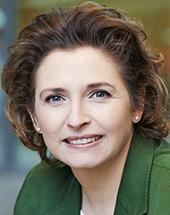 headshot of Nicola BEER