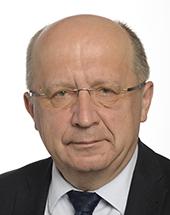 headshot of Andrius KUBILIUS