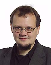 headshot of Tobias PFLÜGER