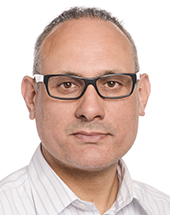 headshot of Ismail ERTUG