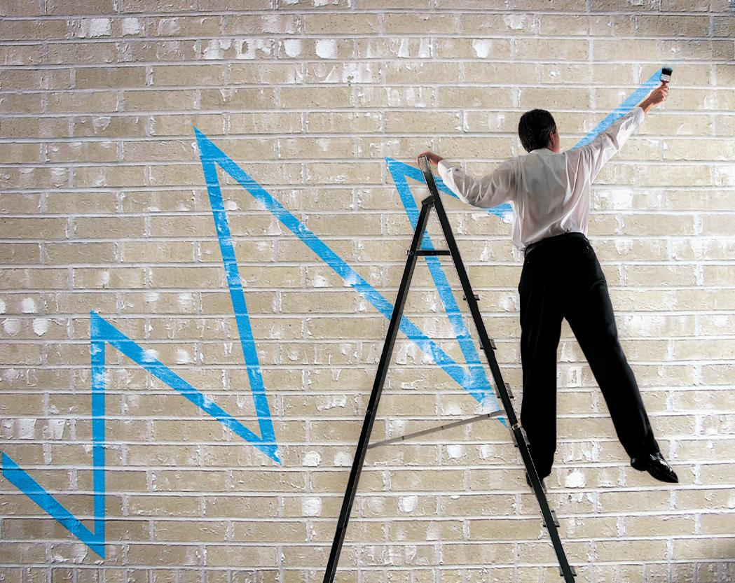 Man painting a chart of a line on a wall