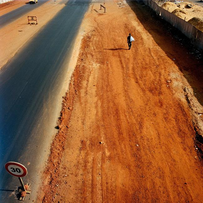 Taken in Dakar, Senegal, a road under construction symbolises hope of a better life for those who pass along it. © Mimi Mollica / www.mimimollica.com