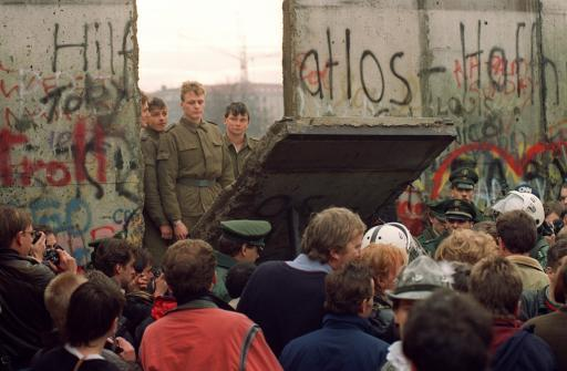 11 November 1989: West Berliners watch East German border Guards knock down pieces of the Berlin Wall. ©Belga/AFP/G.Malie