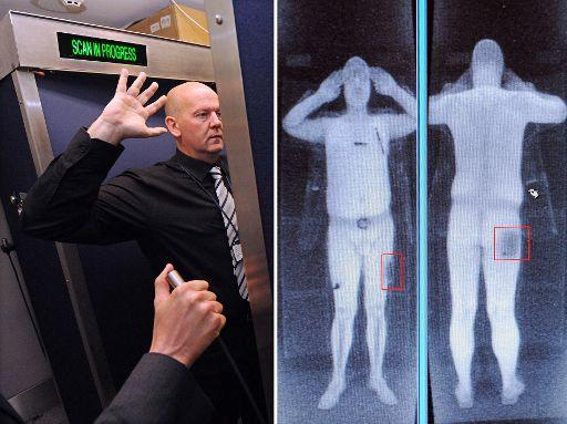 The future exposed? A man demonstrates a body scanner. Manchester Airport, October 2009 ©Belga/AFP/P Ellis