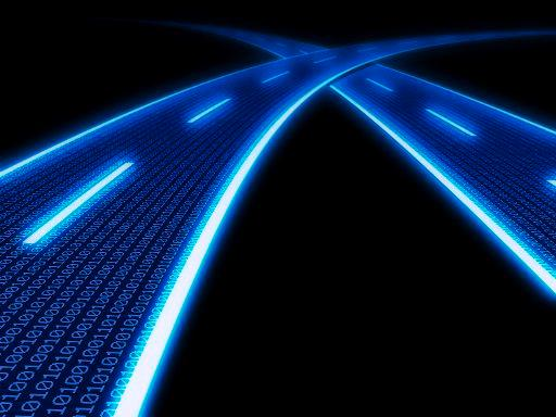 Stylized glowing blue highway with binary code. ©BELGA_imagebroker_Simone Brandt