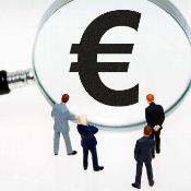People looking at a euro sign through a looking glass