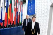 Speaker of the European Parliament Jerzy Buzek is led by an usher into the Chamber to open every session.