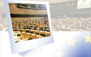 A computer screen with a photo of a committee meeting in it
