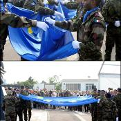 Soldiers carrying and then folding EU flag
