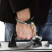 Man with briefcase handcuffed to his wrist