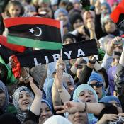 Libyans wave new national flag in the city of Misrata October 23 2011 ©BELGA/AFP/P.Desmazes