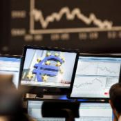 Trader watching screens showing the German DAX index ©BELGA_AFP_F.RUMPENHORST
