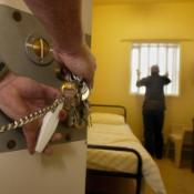 A guard locking a prison cell ©BELGA_PRESSASSOCIATION