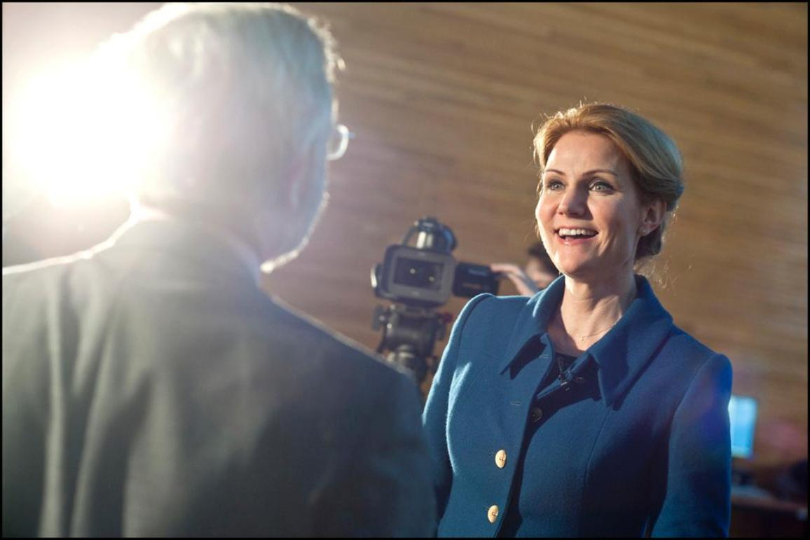 Danish Prime Minister Helle Thorning-Schmidt smiles as she is interviewed