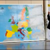 Someone looking at a large map of Europe