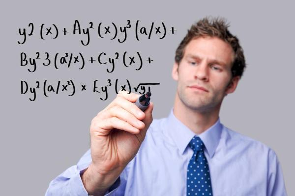 Teacher writing a mathematical equation on a glass screen