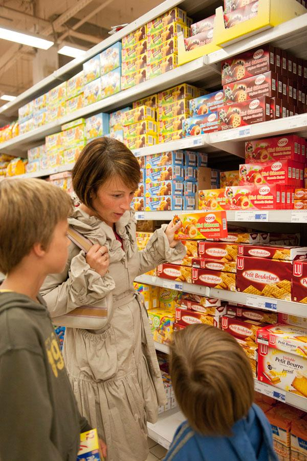 This illustration picture shows a mother and her two sons as they are shopping in a supermarket