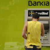 Man using ATM in Spain