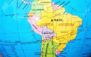 Globe (Latin America) on man hand