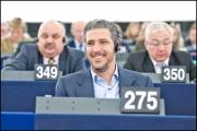Rapporteur Pablo Arias Echeverría smiles as his report has been approved