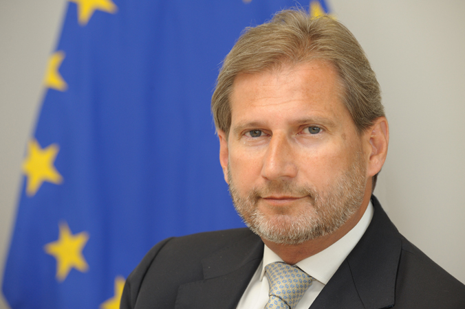 Profile picture of Commissioner for Budget and Human Resources, Mr Johannes Hahn, against background with EU flag