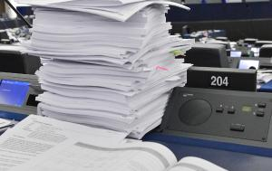 A pile of documents in the plenary Chamber