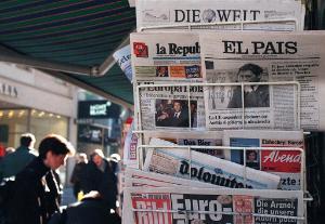 International newspapers at a kiosk