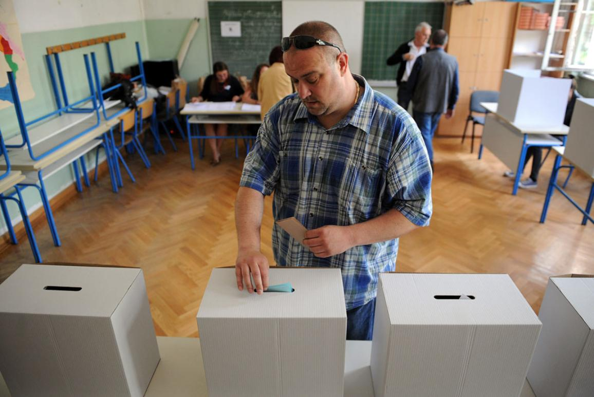 A man casts his ballot at a polling station