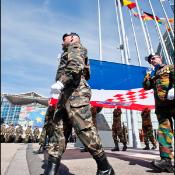 Soldiers carrying a Croatian flag
