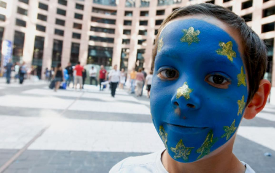 Boy outside the Parliament in Strasbourg