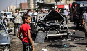 A child stands near the site of a bombing in Cairo