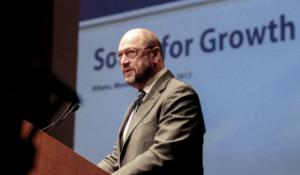 """Martin Schulz, at he podium during the """"South for Growth"""" conference, at the Athens Music Megaron"""