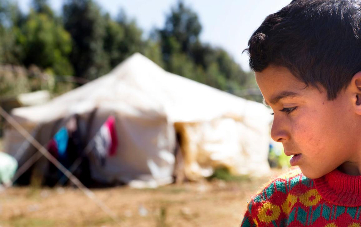Photo d'un enfant syrien dans un camp de réfugiés