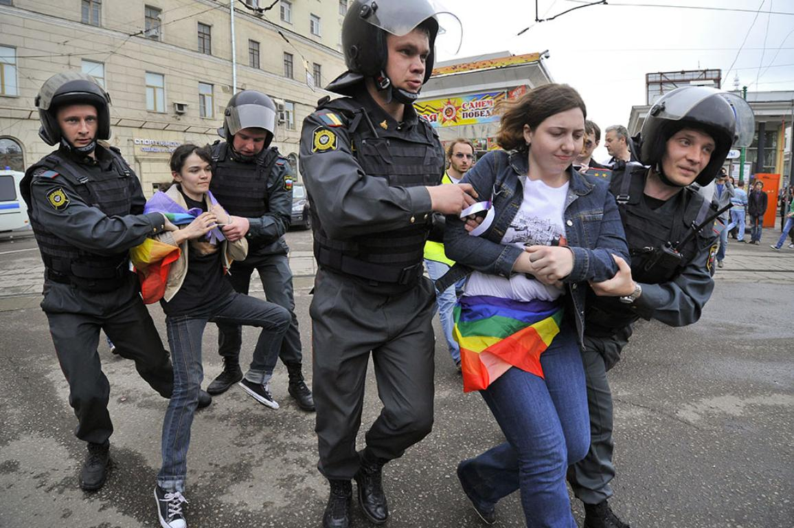 Police detain a participant in an unauthorized protest rally