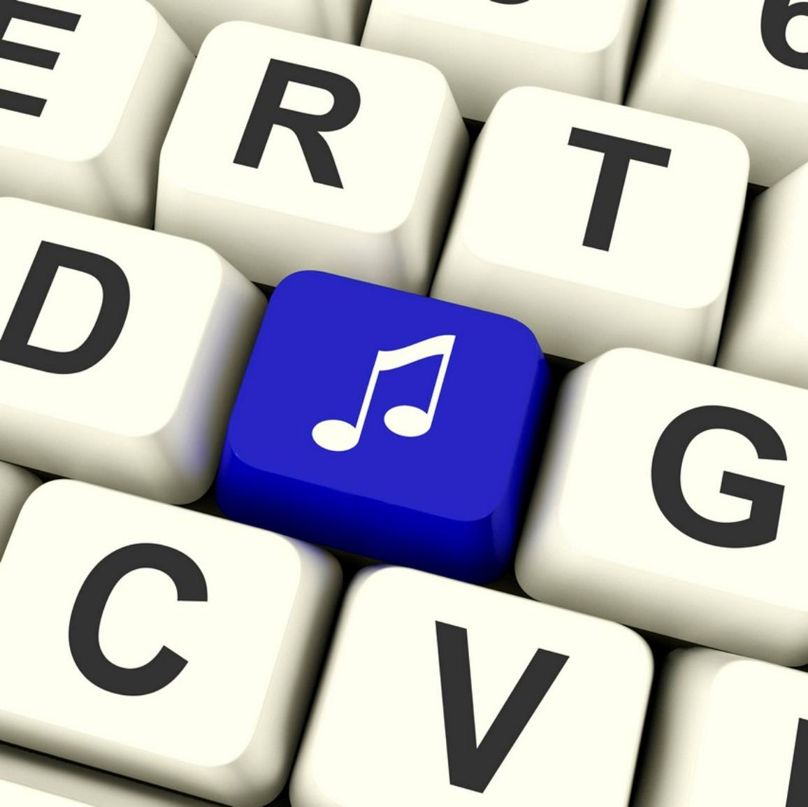 Music Symbol Computer Key In Blue Showing Online Audio