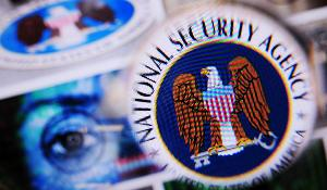 A magnify lens and the NSA logo ©BELGA/DPA/N.Armer